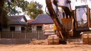 Stock Video Footage of KOH SAMUI, THAILAND - JUNE 21: Excavator rides in construction site quarry.