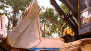 Stock Video Footage of KOH SAMUI, THAILAND - JUNE 21: Close up of wheel loader Excavator rides in
