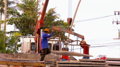 KOH SAMUI, THAILAND - JUNE 21: Crane activity at construction site, workers Stock Footage