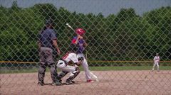 Batter hitting pitched baseball - Slow motion Stock Footage