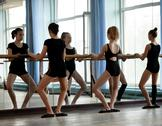 Stock Photo of Ballet dancers warming up