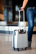 Collecting luggage at the airport Stock Photos