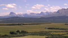 Canada Alberta Rocky Mountains in distance from plains s Stock Footage