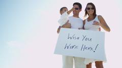 Smiling Caucasian Parents Child Advertising Slogan Board Stock Footage