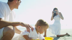 Devoted Young Parents Baby Boy Outdoors - stock footage
