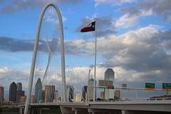 View of Margaret Hunt Bridge with Dallas Skyline - stock photo