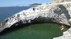 Little boy jumps in to Giola, Natural Pool, Thassos Greece Stock Footage