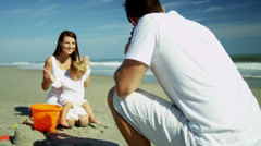 Happy Caucasian Parents Photograph Baby Son Beach Vacation Stock Footage