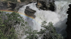 Canadian Rockies  Jasper NP Athabasca Falls with rainbow c Stock Footage