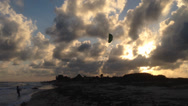 Stock Video Footage of Kite Flying On Beach With Sunset