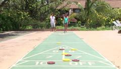Couple Playing Shuffleboard Real Time Stock Footage