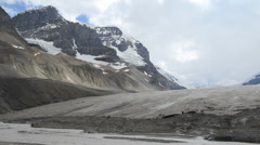 Canadian Rockies Athabasca Glacier tiny figures on ice Stock Footage