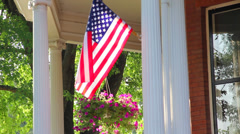 American flag waving in the wind on a porch 2 - stock footage