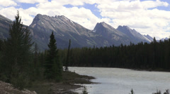 Canada Icefields Parkway Athabasca River with stark mountains s - stock footage