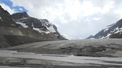 Canadian Rockies Athabasca Glacier stream at edge of ice Stock Footage