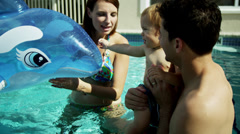 Healthy Caucasian Parents Young Child Swimming Pool Fun Stock Footage