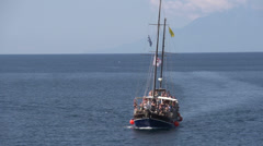Junk sailboat arriving at giola in Thassos Greece Stock Footage