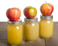 Jars of homemade applesauce with apples Stock Photos