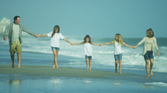 Casual Dressed Caucasian Family Outdoors Together Beach - stock footage