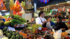 Buyers of fruits & vegetables at the La Boqueria food market. Barcelona, Spain. Stock Footage