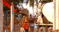 KOH SAMUI, THAILAND - JUNE 21: Industrial Crane operating and lifting cement Stock Footage