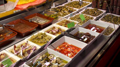 Spanish Olives & Pickles at the La Boqueria food market. Stock Footage