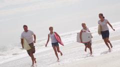 Three Caucasian Girls Parents summer Beach Vacation Bodyboards - stock footage