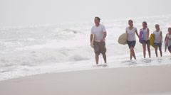 Carefree Caucasian Family Enjoying Autumn Beach Vacation Stock Footage