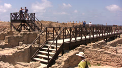 Walkway with lookout tower constructed over ruins at Paphos Stock Footage