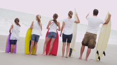 Young Caucasian Girls Parents Beach Body board Surfboard Stock Footage