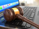 Stock Illustration of online internet auction. gavel on laptop.