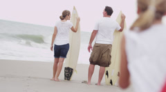 Caucasian Family Beach Waves Holding Surf Boards Arkistovideo