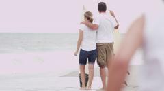 Three Caucasian Girls Parents Fall Beach Vacation Bodyboards Stock Footage