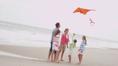 Caucasian Family Fun Bright Colored Kite Flying Stock Footage