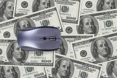 Stock Photo of one hundred dollar banknotes with computer mouse
