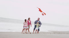 Happy Caucasian Family Group Warm Clothes Flying Kite - stock footage