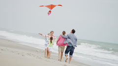 Parents Three Young Caucasian Daughters Beach Kite Summer - stock footage