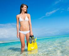 Woman on tropical island with snorkel gear Stock Photos