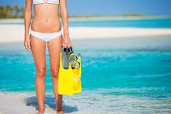 Woman on tropical island with snorkel gear Kuvituskuvat
