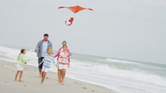 Happy Caucasian Summer Family Group Warm Clothes Flying Kite - stock footage