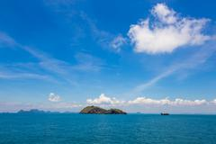 blue sky expanse of the sea and white clouds - stock photo
