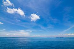 blue sea and white cloudy - stock photo