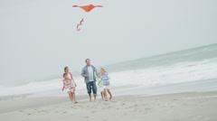 Three Caucasian Girls Parents Fall Beach Vacation Toy Kite Stock Footage