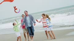 Caucasian Family Fun Bright Colored Kite Flying - stock footage