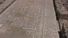 Ancient Roman floor mosaic ruins covering a long corridor Stock Footage