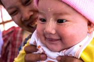 Stock Photo of kyaikto, myanmar - dec 14, 2012: an burmese woman with her baby in december 1