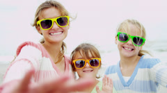 Three Caucasian Girls Fall Beach Vacation Photo Messaging Stock Footage