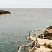 Stock Photo of Wooden dock and a distant shore