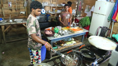 Local chefs working in a restaurant kitchen in Weligama, Sri Lanka. Stock Footage
