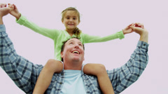Young Caucasian Girl Riding Dads Shoulders Enjoying Fall Beach Vacation Stock Footage